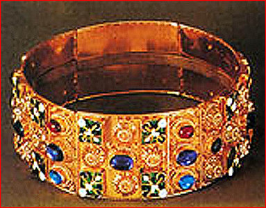 "IRON CROWN OF LOMBARDY<br /> <br /> ""The Iron Crown of Lombardy (Corona Ferrea) is both a reliquary and one of the most ancient royal insignia of Europe. It is kept in the Cathedral at Monza near Milan, the capital of Lombardy. <br /> <br /> Antiquity:<br /> <br /> The Iron Crown is so called from a narrow band of iron about one centimeter (three-eighths of an inch) within it, said to be beaten out of one of the nails used at the Crucifixion. According to tradition, the nail was first given to Emperor Constantine I the Great by his mother Saint Helena, who discovered the Cross. <br /> <br /> How it fell into the hands of the Lombard Kings, Germanic conquerors of northern Italy, is not well explained. <br /> <br /> The outer circlet of the crown is of six gold and enamel segments of beaten gold, joined together by hinges and set with precious stones that stand out in relief, in the form of crosses and flowers. <br /> <br /> Its small size and hinged construction have suggested to some that it was originally an armlet or perhaps a votive crown that was presented to the Cathedral of Monza, where it is preserved as a holy relic. <br /> <br /> Modern uses:<br /> <br /> On March 1, 1026, Heribert, the archbishop of Milan, crowned Emperor Conrad II at Milan with the Iron Crown of Lombardy. <br /> <br /> From the 9th to the 12th century the Kings of Italy received the Iron Crown of Lombardy at Pavia. <br /> <br /> On the May 26, 1805, Napoleon Bonaparte had himself crowned King of Italy at Milan, with suitable splendor and magnificence. Seated upon a superb throne, he was invested with the usual insignia of royalty by the Cardinal Archbishop of Milan, and ascending the altar, he took the iron crown, and placing it on his head, exclaimed, being part of the ceremony used at the enthronement of the Lombard Kings, Dieu me le donne, prendre garde ceux qui il touche – ""God gives it to me, beware those who touch it"". <br /> <br /> On the occasion, Napoleon founded the Order of the Iron Crown, on June 15, 1805. After Napoleon's fall and the annexation of Lombardy to Austria, the order was re-instituted by the Austrian Emperor Francis I, on January 1, 1816. <br /> <br /> Emperor Ferdinand I was crowned King of Lombardy and Venetia in Milan on September 6, 1838, using the Iron Crown. <br /> <br /> After the war between Austria and Italy, when the Austrian had to withdraw from Italy in 1859, the Iron Crown was delivered to Victor Emmanuel, the Savoy King of Piedmont-Sardinia and soon after of re-united modern Italy. <br /> <br /> A surprising image of the Iron Crown figures in Chaper 37 ""Sunset"" of Herman Melville's Moby-Dick. The brief chapter is devoted to Captain Ahab's soliloquy. Among his delusions of persecution and of grandeur, he imagines himself crowned with the Iron Crown of Lombardy."" <br /> <br /> SOURCE: <a href=""http://en.wikipedia.org/wiki/Iron_Crown_of_Lombardy"">http://en.wikipedia.org/wiki/Iron_Crown_of_Lombardy</a>"