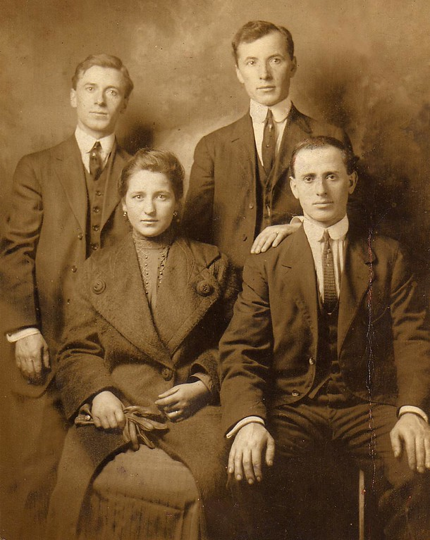 1912<br /> <br /> Top left to right: Brothers Antonio 'Tony' Lombardi, Battista 'Jack' Lombardi.<br /> Bottom left to right: Maria 'Mary' (Fusi) Lombardi, Giuseppe 'Joe' Lombardi (Maria's husband and brother to Antonio and Battista).<br /> <br /> Photo was taken on Maria's arrival from Italy to the USA in 1912.<br /> <br /> ***Interesting Note: Maria was to make the Atlantic Ocean journey to America with several female friends, each coming to America to meet their husbands who had already immigrated to the US. They purchased their tickets and awaited the day of the voyage. However, one of the women was an alcoholic, and sold her ticket for money to buy drinks.<br /> <br /> An attempt was made to purchase another ticket to their ship, but none were available. Wanting to stay together, the other women returned their tickets for a refund, and purchased tickets to another ocean-liner.  <br /> <br /> The ship's tickets that Maria and her friends returned were for the RMS TITANIC.