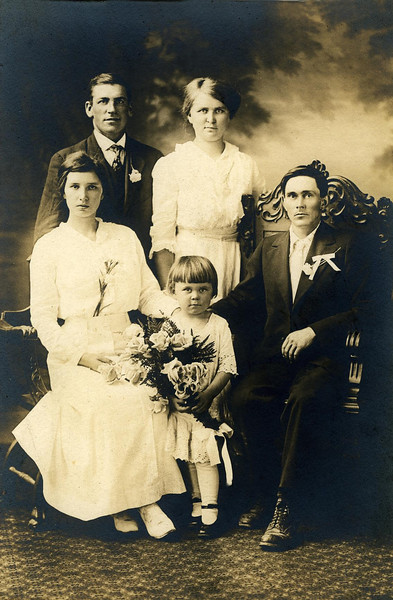 """Wedding photo for Sanford Edward Clark (son of William David and Amelia (Liebe) Clark) and Eva Jane Mapes. Witnesses for the marriage, which took place at the Manitowoc Courthouse, were Sanford's cousin Albert and Ella Braunsdorf and their daughter Mabel. Albert was the son of Christ and Hulda (Liebe) Braunsdorf, and was the captain of the barge """"Adriatic"""" on which Sanford worked as a fireman."""