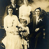 "Wedding photo for Sanford Edward Clark (son of William David and Amelia (Liebe) Clark) and Eva Jane Mapes. Witnesses for the marriage, which took place at the Manitowoc Courthouse, were Sanford's cousin Albert and Ella Braunsdorf and their daughter Mabel. Albert was the son of Christ and Hulda (Liebe) Braunsdorf, and was the captain of the barge ""Adriatic"" on which Sanford worked as a fireman."