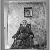 "<i><b>MARTHA MERRITT NORMAN (1835-1901)</b></i> This undated photograph shows Martha Merritt Norman seated in front of a photo of her husband, John Norman, who was likely deceased when this was taken.    Born in Indiana to George and Elizabeth (Scott) Merritt, her family moved to Iowa by the time she was a teenager. The 1850 census shows the family living at Fox in Davis County Iowa.  At about age 17, in February 1852, she married John Norman in Davis County.  Over the next 30 years, John and Martha 10 children, including Alatha (Norman) Durham, who would become mother of Leota (Durham) Maiden.  In addition to Fox County, the Normans also lived in Decatur and Page counties.  By 1870, their home was in Cherokee County.  John Norman died in 1882, and Martha reportedly married a widower named Thomas Phillips in 1877.  At the time of the 1900 census, Martha and Thomas lived in Aurelia, Iowa.  Martha died at Meriden, Iowa on 13 August 1901.  The cause was ""illness related to burns."" (Photo courtesy of Doug Henderson)"