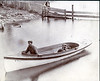 Calvin Mapes and a boat he made