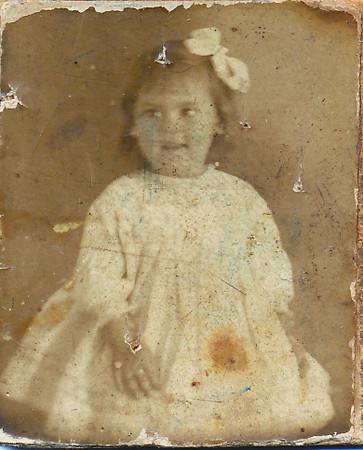 This was a very small (slightly larger than postage stamp), very old photo, much older and of a thicker type than those of Joe and Lena's kids when young. Looks like 1860-180 vintage. Could this be Lena as a child?