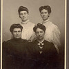 Sitting:  Sallie Aston, Mary Aston; Standing: Edna Aston, Eva Aston (right side). [I see a lot of dad in this picture of Eva-mhw]