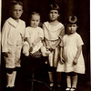 Horace, Kenneth, Christine and Ruth Meaders.  I estimate this picture was taken in 1919 when Kenneth was 1 year old. That would make Ruth ~3, Christine ~5 and Horace ~6 years old.