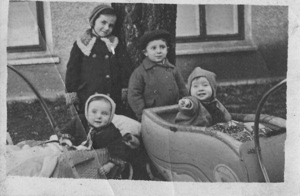 """Survivors - on the Road""  Back:  Barbara and Fred ; first cousins Front: Loretta and Irving ; first cousins  Fred and Irving: brothers Barbara and Loretta: sisters On the road to the displaced persons camp from Crimea, USSR after WW II About 1947"