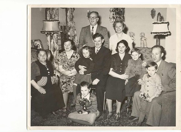 """Greenhorns!  First arrival in the U.S.  From left front: Ida Altman, mother of Fried; Leah Lopata; Loretta Lopata; Wolf Lopata (Velvul); Frieda Feldman, Fred Feldman, Mendel Feldman Front: Barbara Lopata; Irving Feldman Rear standing; Joseph Rosenbaum; Anna Rosenbaum  October 1949; South Bend, Indiana"