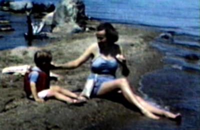 1948 Nipigon, Ontario Jane with Miles on rocky shoreline of Lake Nipigon.