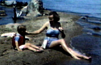 1948 Nipigon, Ontario Jane with Miles on rocky shoreline of Lake Nipigon.