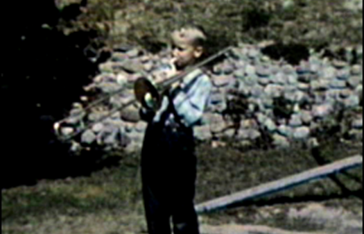 1959 Sioux City, IA Mark rehearsing with trombone in backyard of 3630 Jennings St.
