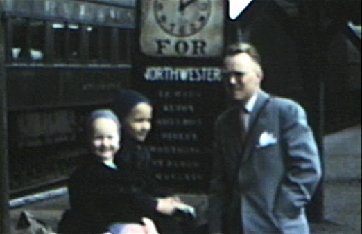 1951 Sioux City, IA Morrie with Miles and Mark at the downtown CN&W train station. Waiting for train that takes us to Worthington, MN.