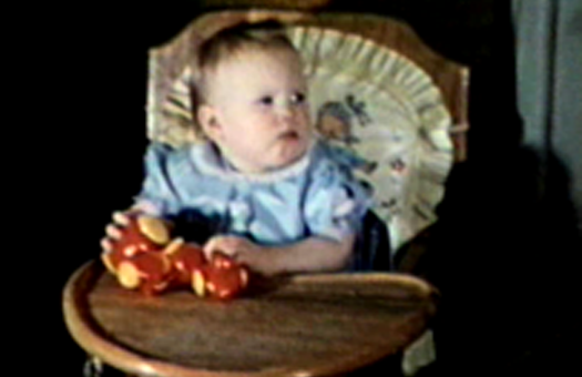 1953 3630 Jennings St., Sioux City, IA Mary Jane's first birthday,  in her highchair