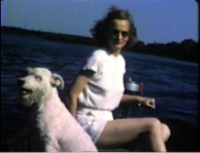 1947 Lake Okoboji, Arnolds Park, IA Jane with family's wired hair terrier, Jenifer