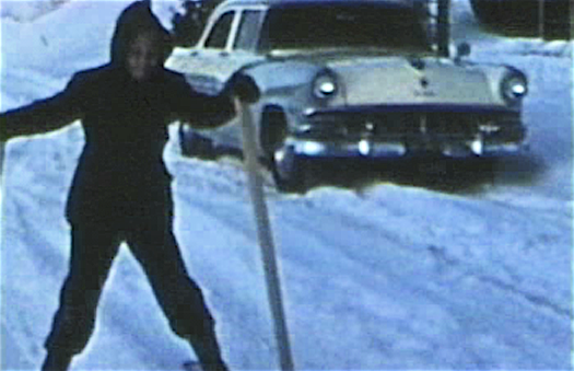 1956 Sioux City, IA Mark snow skiing in street in front of house at 3630 Jennnings St.