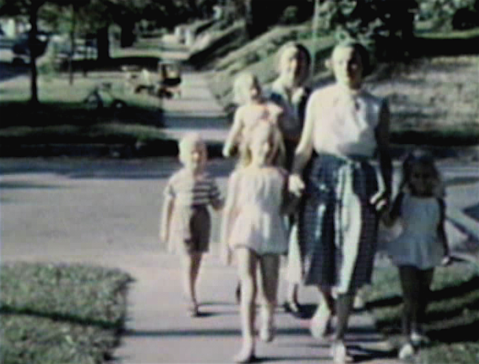 1953 Sioux CIty, IA Eloise with her daughters, Wendy and Kathy. Geggy following with Mark and Mary Jane. On sidewalk in front of 3738 Jackson Street.