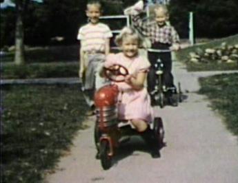 1957 3630 Jennings Street, Sioux CIty, IA MJ driving Craig Butzloff's toy tractor.