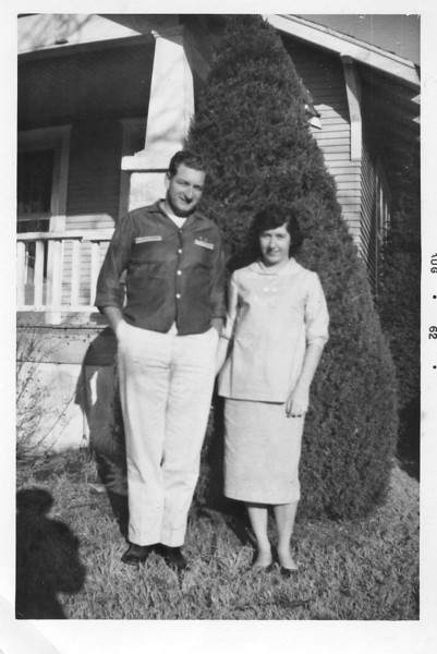 Mom and Dad, in front of grandma and grandpas house on Sheridan.