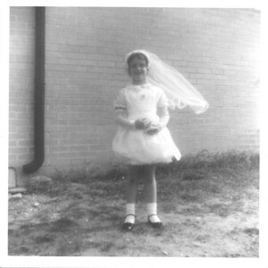 My First Communion. Posed at the side of St. John Vianney Church in Allandale.