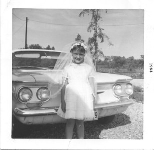 My First Communion. Posed in front of our yellow Corvair.
