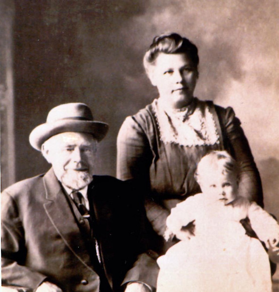 Emma (Trueblood) Anderson with her step-father Andrew Johnson and daughter Elsie