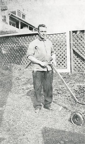 Arthur Nolin doing yard work, in the 1920s
