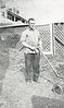 Arthur Nolin doing yard work, in the 1920s
