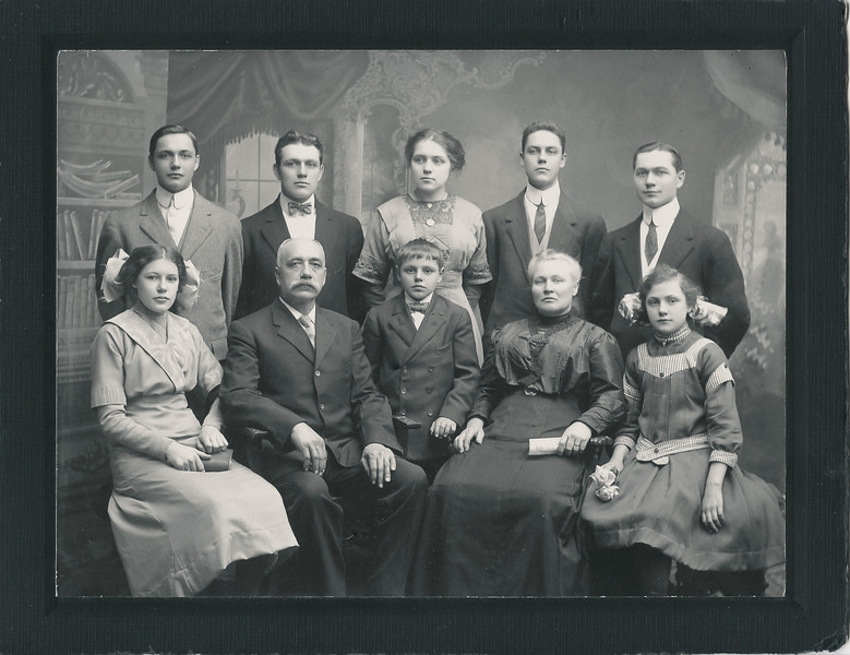 "The Nolin Family.  Back row, left to right, Ovila, Arthur, Ida, Pierre (""Peter""), Joseph.  Front row, left to right, Louise, Aristide, Homer, Olivine, Eva"