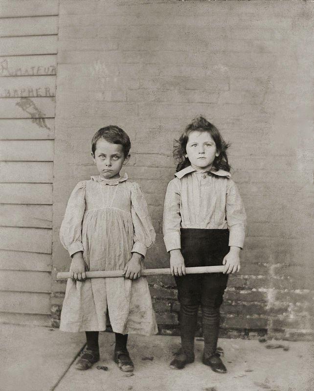 Arthur Ogle and Jessie Ogle about 1898. Their mothers probably instigated the clothing exchange, but Arthur did not think the idea was funny at all, probably since he was not long out of dresses.