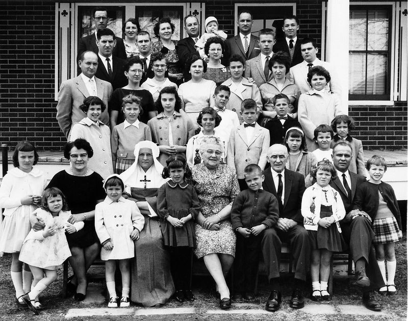 THOMAS & ÉMILIE (My mother's mom & dad) A family gathering happened every few years - here I (Jean Roger) was only 14 years old  - upper right corner, second row down, first one)