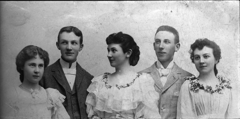 Mid to late 1890s?  From Left to Right, I believe the first three are Margaret May Brown (Innes) (1874-1946), Walter Pease Innes (1873-1958), Anna Elizabeth Brown (Woods) (1876-1951), unknown man and unknown woman.
