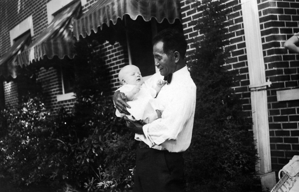 Billy Fujimoto, who worked for Uncle Phil (Phillips), holds Lee Phillips III.  Ca. 1931.