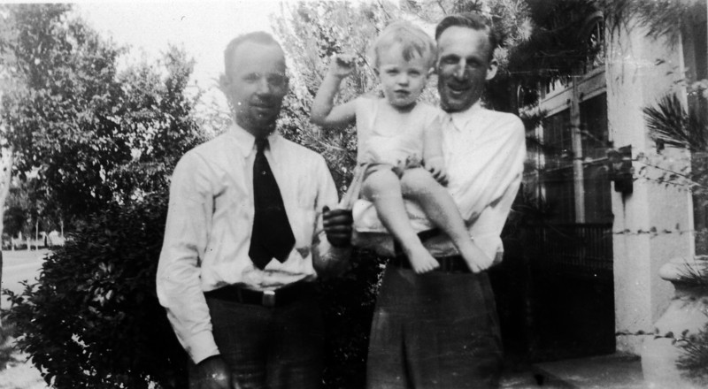 Aug. 6, 1933 (written on back).  Lee Phillips Jr. and Phil Phillips with Lee Phillips III.