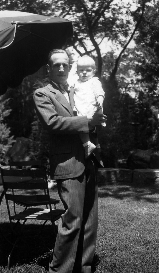 May 16, 1932 (written on back).  Uncle Phil (Phil Phillips) with Lee Phillips III.