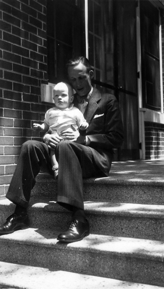 Feb. 24, 1932.  (Written on  back.)   Uncle Phil (Phil Phillips) with Lee Phillips III.