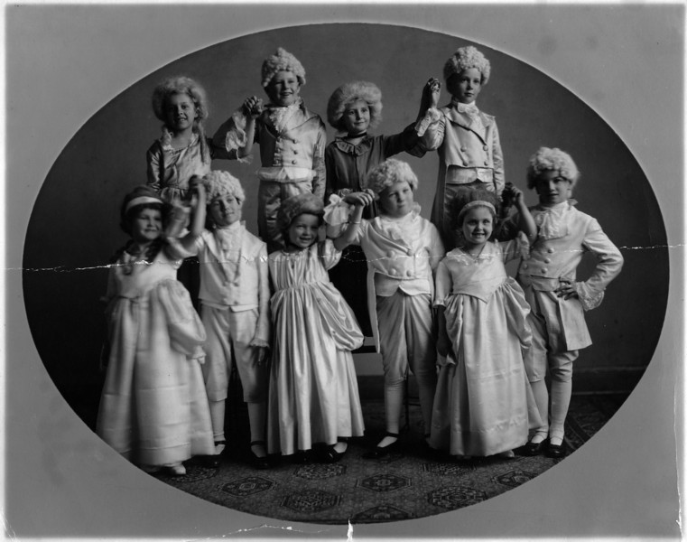 Top row, first on right:  Lee Eldas Phillips Jr.  (1905-1977).  Written on back:<br /> Left to Right<br /> Top row - Ruth Foster - Dean Law - ? - Lee Phillips<br /> Bottom row - Ruth Burlingame - John Kane - ? - Bill Larkin - Marie Foster - ?<br /> <br /> Attached note reads:<br /> Dick - Attached is an old picture that I would like to have you deliver to Lee Phillips - I don't have Lee's address but I'm sure you know him -- he is an indepent. operator in Wichita.  If you are not now calling on him you should be.  Give him my very best.  Thanks,  Bill.  from the desk of W.H. Larkin