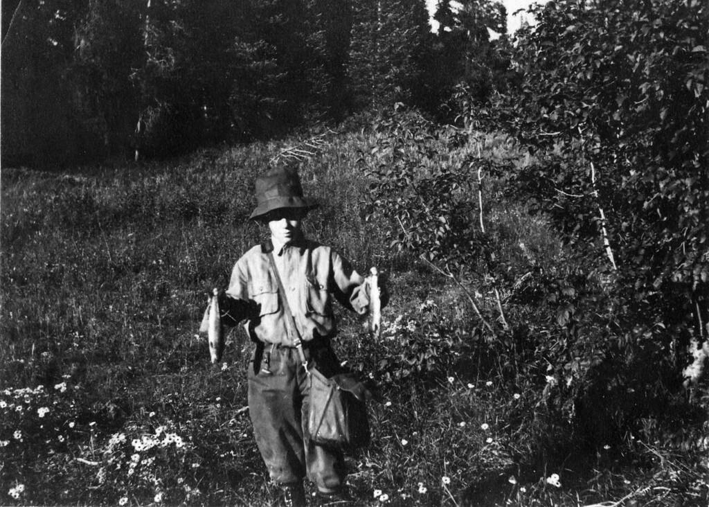 Ca. 1918?  Lee Eldas Phillips Jr. (1905-1979).  Written on back:<br /> Part of his catch same day<br /> Trappers Lake first trout fishing trip