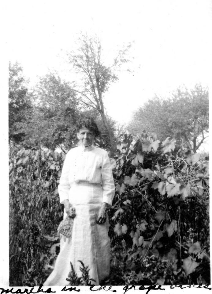 Caption reads: Martha in the grape vines<br /> (Martha Ellen Rogers Carr)