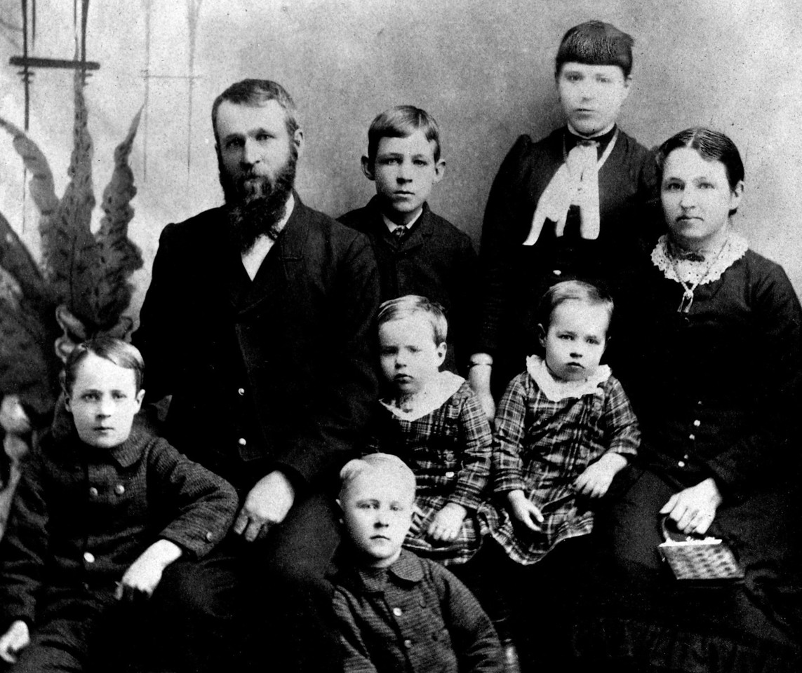 The Phillips family.  Best guess:  back row, left to right:  Frank Phillips, Jennie Phillips;  middle row, left to right: Lewis Franklin Phillips, twins Waite & Wiate Phillips, Lucinda Faucett Phillips;  front row, left to right:  Lee Eldas Phillips, Edward Phillips.  Probably about 1885.