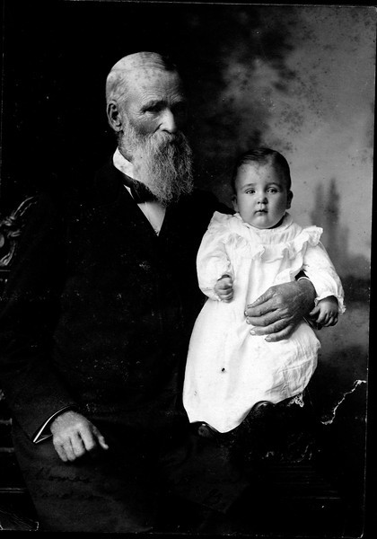 Caption reads:  Thomas L. Faucett with his great-grandson John G. Phillips.  Taken about 1900.