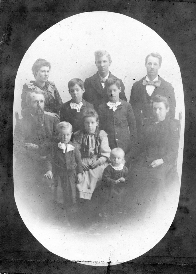 The Phillips family.  Best guess:  back row, left to right:  Jennie Phillips, Ed Phillips, Lee Phillips;  middle row, left to right: Lewis Franklin Phillips, twins Waite & Wiate Phillips, Lucinda Faucett Phillips;  front row, left to right:  Fred Phillips, Nellie Phillips, Luna Phillips.  Circa 1893.