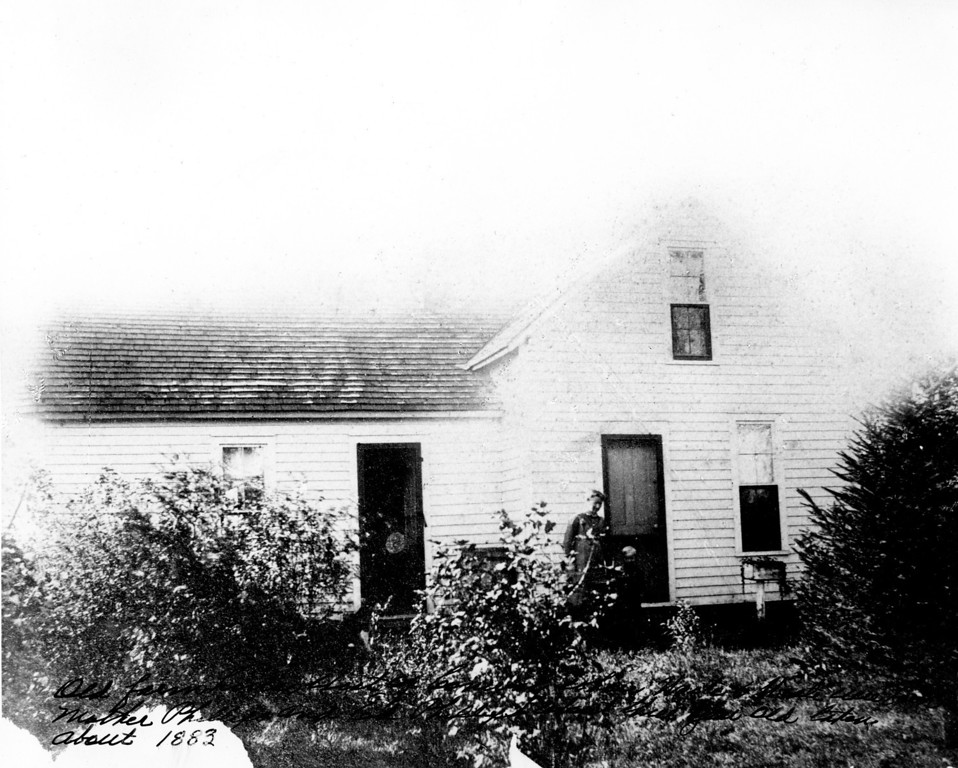 Caption reads:  Old farmhouse West of Conway where Waite and Wiate were born.  Mother Phillips and Ed Phillips about three years old.  Taken about 1883.