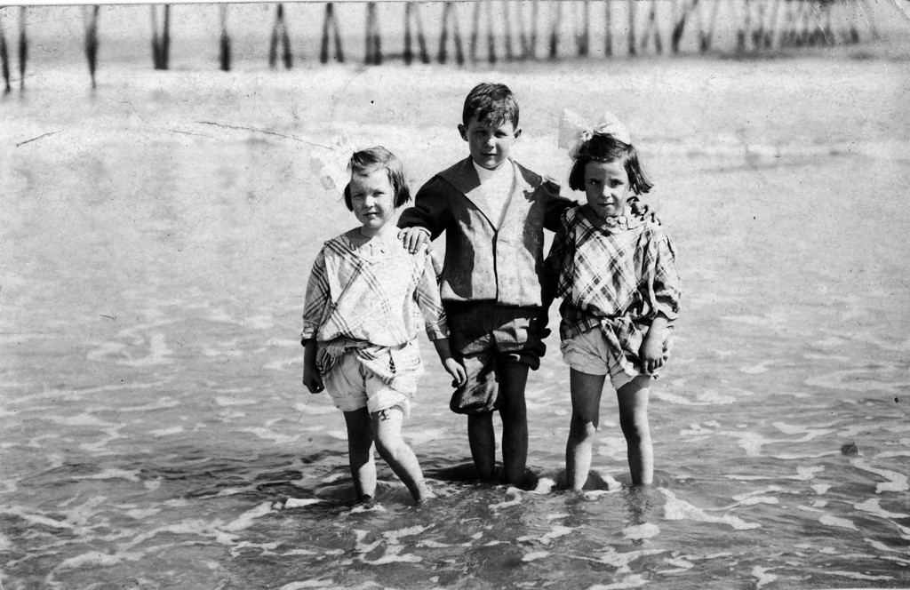 "ca. 1910 Florida.  From left to right:  Anne Katherine Innes (Phillips) (1905-1993), Walter Pease Innes Jr. (1902-1977), Elizabeth Woods (1905-1937).  Postcard, postmark Daytona, FL, Feb. 19, 19___, addressed to Mr. and Mrs. Geo. Brown, Wichita, Kans., 1104 N. Lawrence Avenue, almost certainly written by Margaret Brown Innes:<br /> The picture on the other side speaks of the good times they are having every day.   Walter Jr. went in bathing today.  He will start to school Monday.  We found the folks all well and we were glad to ""arrive"".  This neighborhood is quiet no longer - the youngsters are the busiest you ever saw.  Moving the wood pile ect. ect.   Would love to see Helen in her short clothes.  Mar."