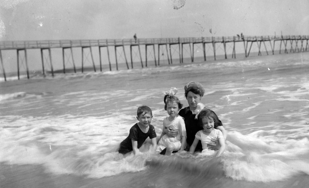 ca. 1910   From left to right:  Walter Pease Innes Jr. (1902-1977), Anne Katherine Innes (Phillips) (1905-1993), Pauline Brown Gillespie, Elizabeth Woods (1905-1937).<br /> Postcard, postmark Daytona, Fla., Mar. 16, 19 --, addressed to Mrs. L. S. Hoffman, cos. Lawrence and Ninth, Wichita, Kansas; written by Margaret Brown Innes:<br /> I want to answer soon your letter which I enjoyed so much.  But in the meantime will send this.  _______ left today.  She was here almost two weeks and we did enjoy it.  Delos will be here next week and I hope Walter also.  Am holding my breath till I know.  Regards to Dr.  MBI