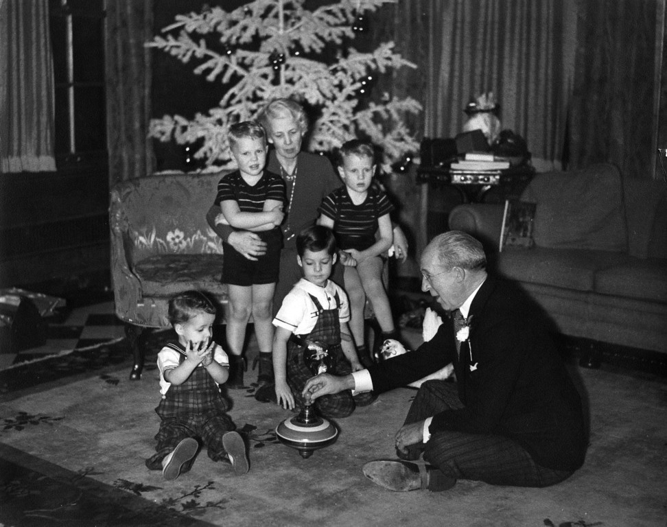 Christmas 1937.  MIss Nodie (Lenora Carr Phillips) with Innes (left) and Lee (right) Phillips.  On floor, Lee Phillips Sr. (1876-1944) plays with James Lee (left) and John Philip (right) Starr.