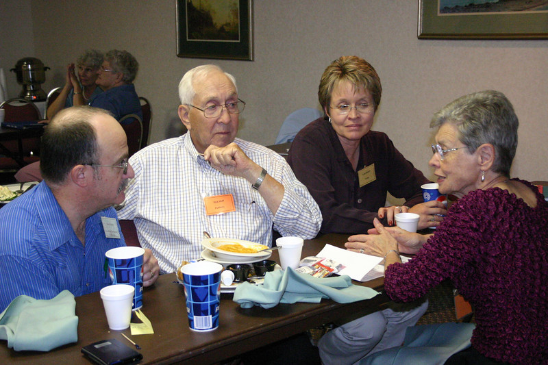 Steve Eberle, Dick Hoff, Leah Rennell talk with Vera Hoff during a working lunch.