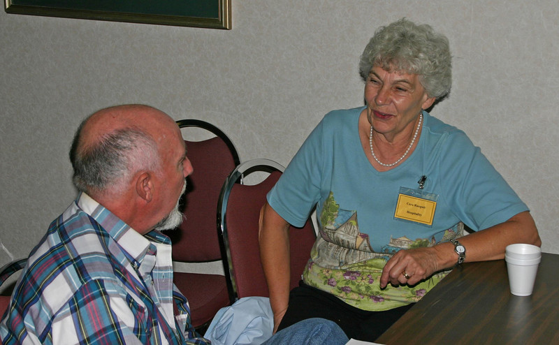 New Casper resident George Bauer visits with Cora Raugutt -- also of Casper.  George will be working on transportation issues, while Cora is GRHS co-chair for Hospitality.