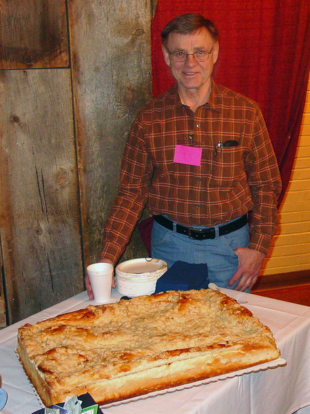 "Okay, it wasn't all work -- we had to eat!  <br /> <br /> Bob Schneider of Spearfish, South Dakota admires a huge Kuchen that added a bit of ""heritage"" to our weekend cuisine.<br /> <br /> Kuchen and other tasty morsels are always an important part of German-Russian gatherings.  2008 in Casper will be no different!"