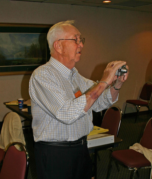 As a co-chair of the Publicity committee, Dick Hoff brushes up on his technique as a photographer.