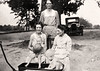Elizabeth Graves Thompson holding Ann Thompson, Joe Thompson in the wagon, Vera Lessie Knight, and seated Elizabeth Lafayette Todd