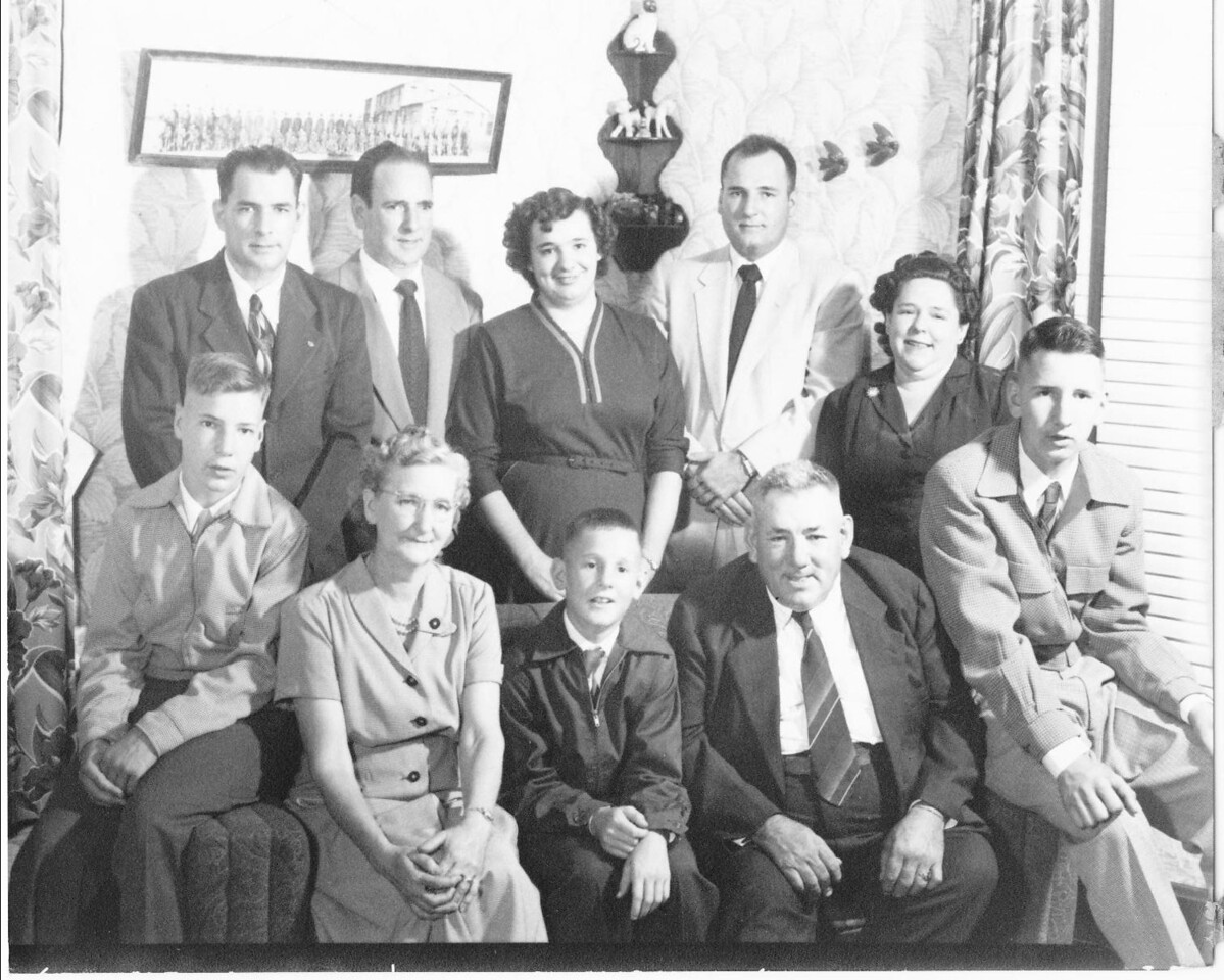 The Family of Roy and Blanche (Howald) Rhodes: Glen Rhodes, Blanche (Howald) Rhodes, Charles Rhodes, Roy Rhodes, Harlan Rhodes, Donald Rhodes, Carl Rhodes, Mary (Girton) Rhodes, Roy Rhodes, Jr., Evelyn (Sanders) Rhodes.
